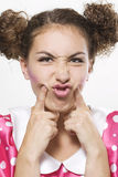 Woman making a funny face. Young beautiful woman making a funny face Royalty Free Stock Photos
