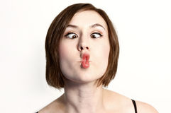 Woman making funny face. A woman making a funny face known as a fishface Stock Photo