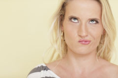 Woman making a funny face. Attractive young woman making a funny face Stock Photos