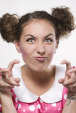 Woman making a funny face. Young beautiful woman making a funny face Royalty Free Stock Image