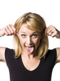 Woman making a funny face. Blond woman making a funny face Royalty Free Stock Photo