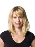 Woman making a funny face. Blond woman making a funny face Royalty Free Stock Images
