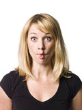 Woman making a funny face. Blond woman making a funny face Stock Photo
