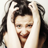 Woman making a funny face. Studio shot Royalty Free Stock Photos