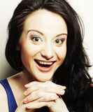 Woman making a funny face. Studio shot Royalty Free Stock Images