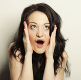 Woman making a funny face. Studio shot Royalty Free Stock Photography