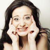 Woman making a funny face. Studio shot Stock Images