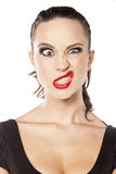 Woman making funny face. Young woman making funny face Stock Photography