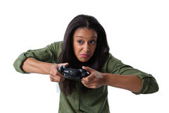 Woman making funny faces while playing video games Royalty Free Stock Image