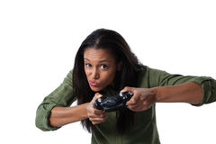 Woman making funny faces while playing video games Stock Image