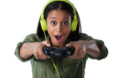 Woman making funny faces while playing video games Royalty Free Stock Photos