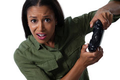 Woman making funny faces while playing video games Stock Images