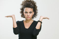 Woman making gestures. Picture of young woman making gestures Stock Photo