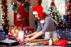Woman making ginger cookies on Christmas Stock Photo
