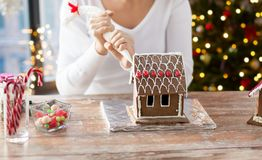 Woman making gingerbread houses on christmas royalty free stock photos