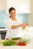 Woman making green salad Royalty Free Stock Image