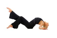 Woman is making gymnastic exercises Royalty Free Stock Photo