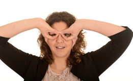 Woman making hand eyeglasses Royalty Free Stock Photos