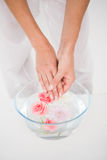 Woman making a hand treatment in a bowl Stock Photo