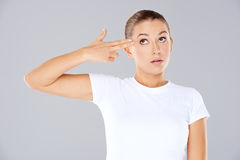 Woman making a handgun gesture Royalty Free Stock Image