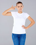 Woman making a handgun gesture Stock Image