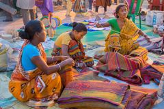 Woman making handicraft products. KOLKATA, WEST BENGAL , INDIA - DECEMBER 3RD 2016 : Unidentified women preparing jute bags, artworks of handicraft, Handicraft Royalty Free Stock Photography