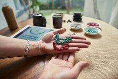 Woman making handmade jewelry stock image