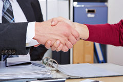 Woman making handshake Stock Image