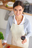 Woman making healthy food standing smiling in Stock Photo