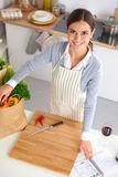 Woman making healthy food standing smiling in Royalty Free Stock Photo