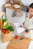 Woman making healthy food standing smiling in Royalty Free Stock Image