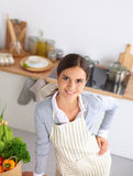 Woman making healthy food standing smiling in Stock Images