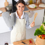 Woman making healthy food standing smiling in kitchen Royalty Free Stock Photos