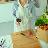 Woman making healthy food standing smiling in kitchen Royalty Free Stock Photo