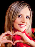 Woman making a heart Royalty Free Stock Photography