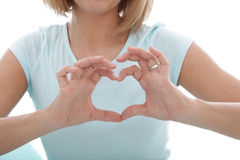Woman making a heart gesture with her fingers Royalty Free Stock Image
