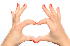 Woman making a heart gesture Royalty Free Stock Photography