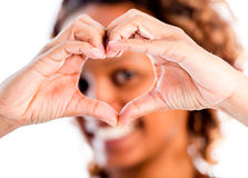 Woman making a heart Royalty Free Stock Image