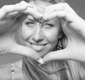 Woman making a heart shape Stock Photos