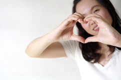 Woman making heart shape Stock Photography