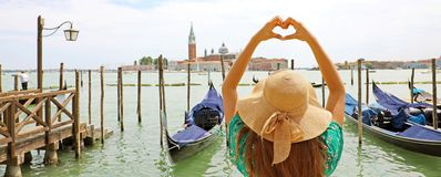 Woman making heart shape with hands on beautiful view of Venice. Panoramic banner view with Venice Lagoon royalty free stock image