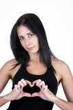 Woman making a heart-shape with her fingers Royalty Free Stock Image