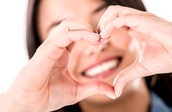 Woman making a heart shape Royalty Free Stock Photo