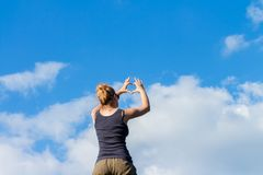 Woman making heart sign with her hands Stock Image