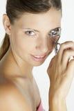 Woman making her eyelashes Stock Photos