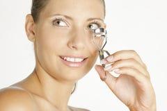 Woman making her eyelashes Royalty Free Stock Images