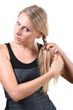 Woman Making Her Hairstyle Royalty Free Stock Photos
