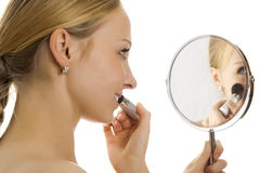 Woman making her make-up. Royalty Free Stock Photo