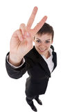 Woman making her victory sign Stock Image