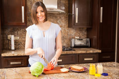 Woman making herself a sandwich Stock Photo